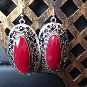 Duze kolczyki srebrne z czerwonym oczkiem