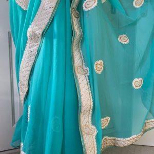 Saree sari pistacjowe ze zlotem