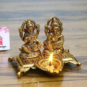 Świecznik Ganesh Lakshmi metal złoto Indie S018