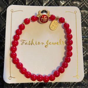 Bransoletka czerwona koraliki chinska  (A042)